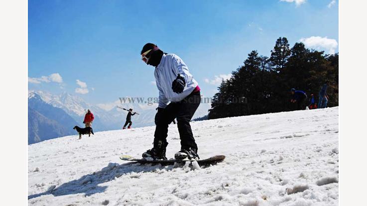 Tourist enjoying skiing