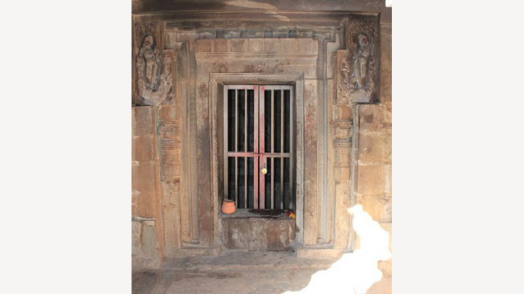 The sanctum is 12.75 feet square outside and about 8 feet square inside. It is covered with a flat roof. Doorway of the sanctum is done in T-shaped style with over-hanging lintel beyond the door-jambs.